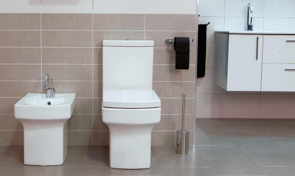 Formas rectas en el baño donde aparecen los sanitarios STARTON de Raifen de Grup Gamma en un baño con tonalidades marrones.