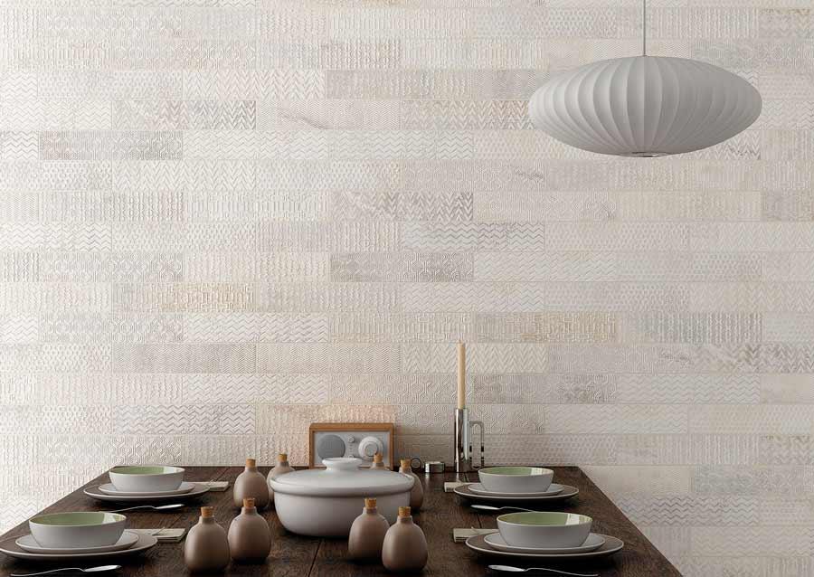 revestimientos paredes gayafores en un comedor la pared est cubierta de cermicas en tonos marrones - Revestimientos De Paredes