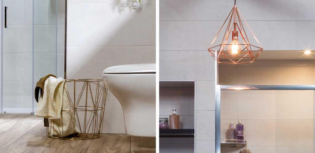 Tendencias cuarto de baño donde se ven una papelera en tono dorados y una lámpara en tonos cobre.